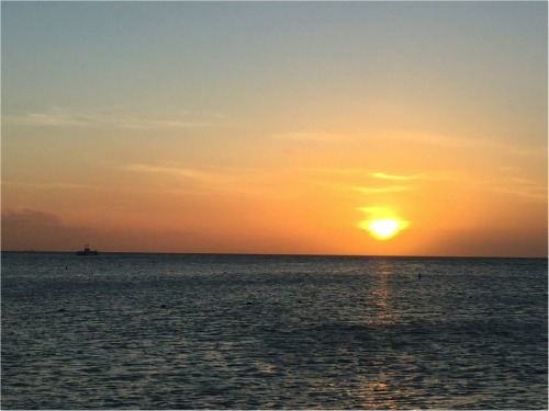 ondergaande zon Aruba reisverlag